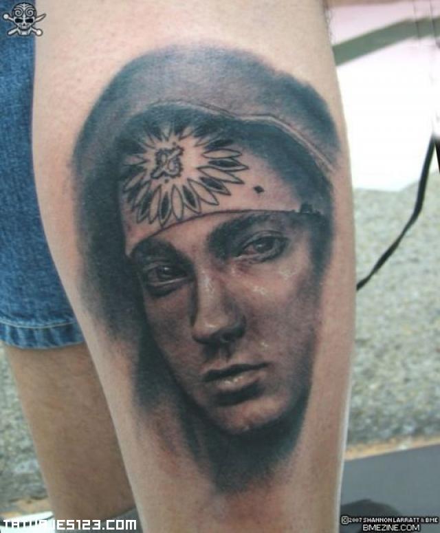 Cara de Eminem en la pierna Tatuajes 123