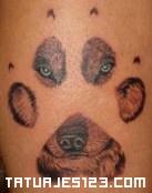 Huella y rostro de perro