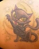 Gato negro con ojos verdes