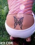 Sexy mariposa en la rabadilla