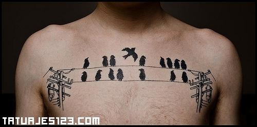 Pájaros en tendido eléctrico